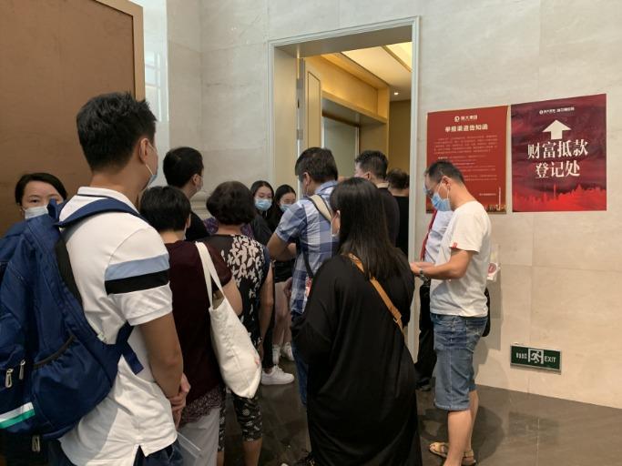 摩臣5平台现场:恒大在广州组织实物兑付登记 投资人要求公示房源明细